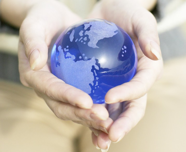 Woman Holding Small Globe